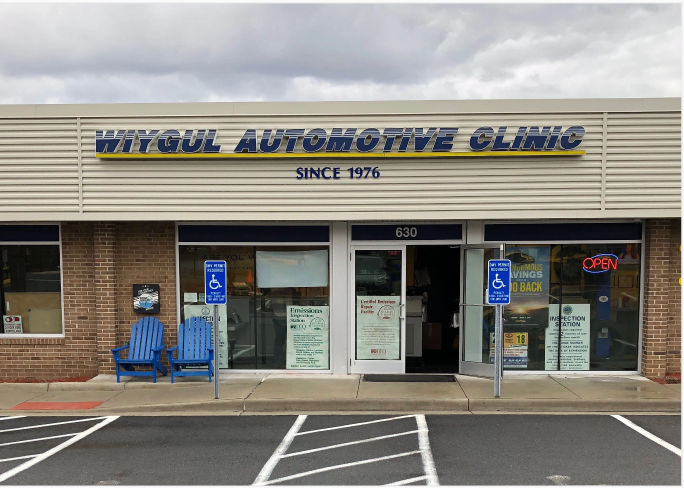 One of Wiygul Automotive Clinic's storefronts with their original logo.